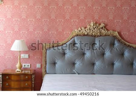 big bed with high headboard - stock photo
