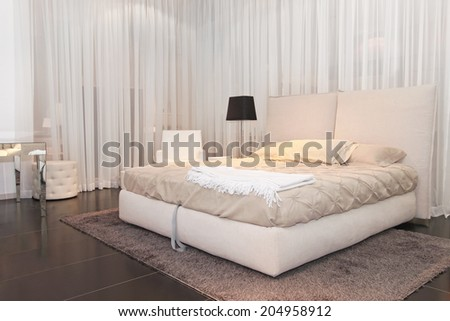 Big bed with in white bedroom - stock photo