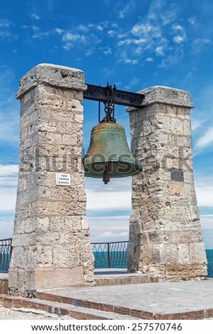 Big bell in the Chersonesus in Crimea, near Sevastopol. focus on the bell - stock photo