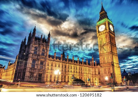 Big Ben and House of Parliament at dusk with clouds from Westminster Bridge - London - UK - stock photo