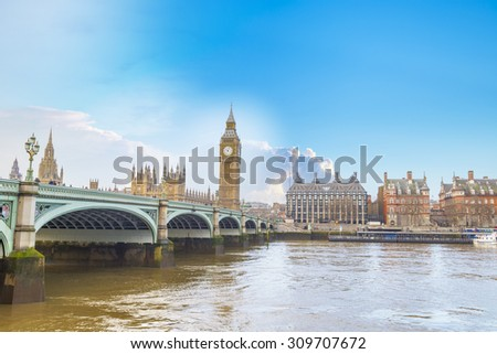 Big Ben and Houses of Parliament with bridge and thames river in London. - stock photo