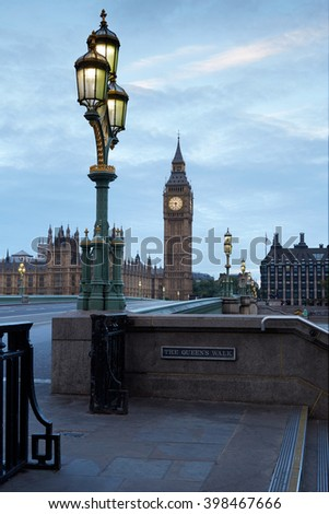 Big Ben and Palace of Westminster, empty bridge in the early morning in London, natural colors and lights - stock photo