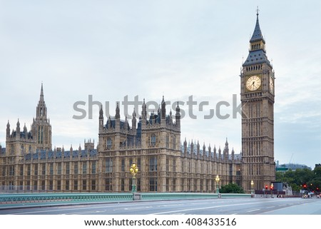 Big Ben and Palace of Westminster in the early morning, empty street in London, natural colors and lights - stock photo