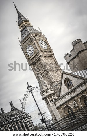 Big Ben and the London Eye in the background. - stock photo