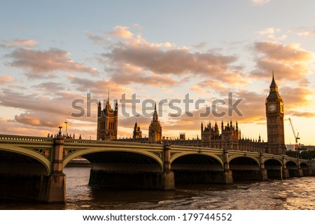 Big Ben and the Parliament with Westminster Bridge in London at sunset. Golden Big Ben and Skyline./Big Ben and the Parliament at sunset in London/Big Ben and the Parliament at sunset in London - stock photo