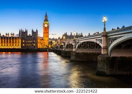 Big Ben and Wesminster Bridge Illuminated in the Evening, London, United Kingdom - stock photo