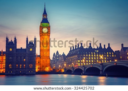Big Ben and westminster bridge at dusk in London - stock photo