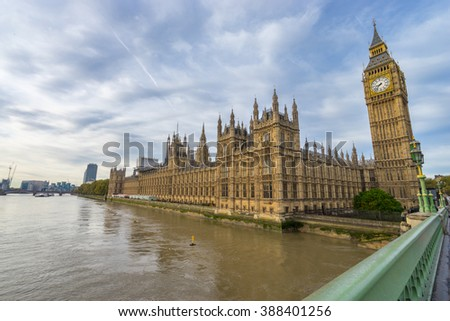 Big Ben and Westminster Parliament seen from Westminster Bridge at cloudy sky in London, the UK. - stock photo