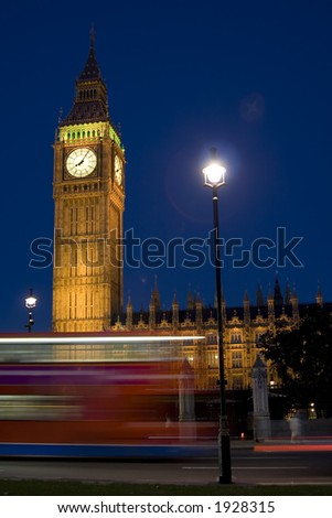 Big Ben at night with light trails