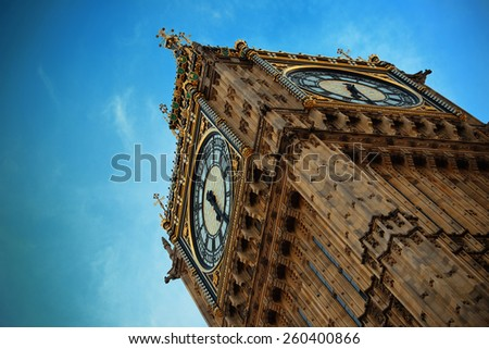 Big Ben closeup in London with blue sky. - stock photo
