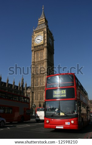 Big Ben - famous clock tower in City of Westminster, part of London with typical red doubledecker in foreground - stock photo