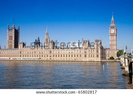 Big Ben, Houses of Parliament overlooking River Thames on bright sunny morning, London England - stock photo