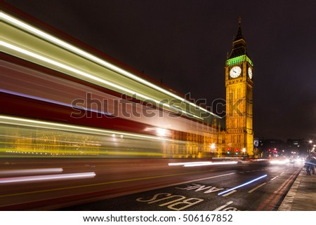 Big Ben, one of the most iconic symbols of England, as shown at night along with the lights of the cars passing by