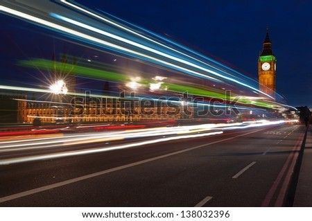 Big Ben, one of the most prominent symbols of both London and England, as shown at night along with the lights of the cars passing by