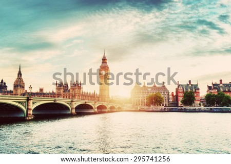 Big Ben, Westminster Bridge on River Thames in London, the UK. English symbol. Sunset sky with some clouds. Vintage - stock photo