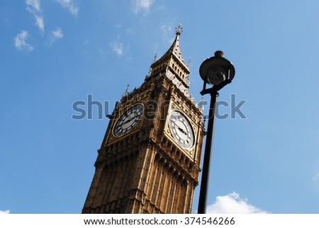Big Ben with a public light post - stock photo