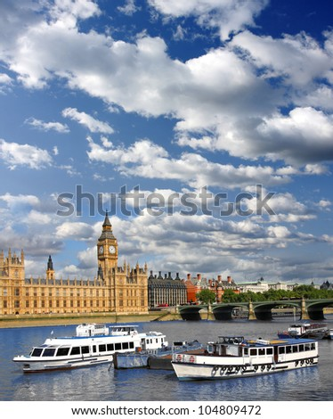 Big Ben with boat and bridge in London, UK - stock photo