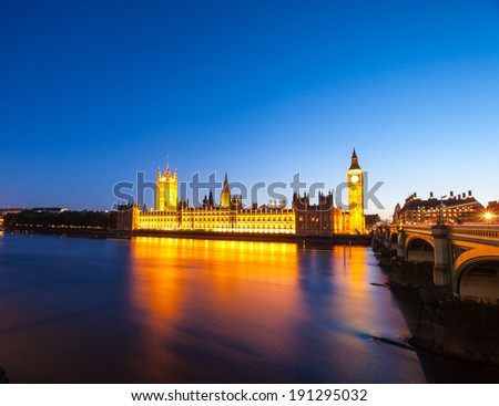 Big Ben with the Houses of Parliament at night in London. - stock photo