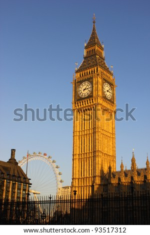Big Ben with the London Eye in the background - stock photo