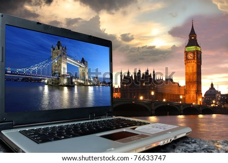 Big Ben with Tower Bridge on screen of notebook, London, UK - stock photo