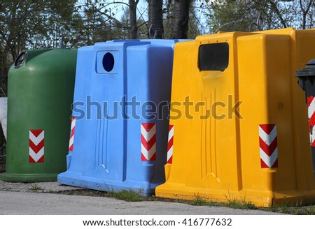 big bins for waste paper collection and for the collection of used plastic and glass bottle