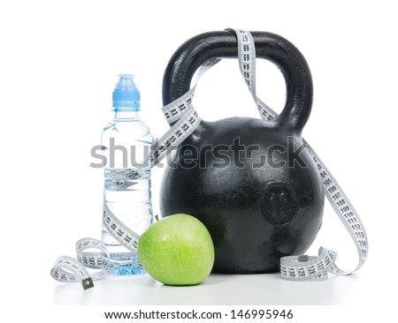 Big black fitness weight dumbbell with tape measure, drinking water and apple isolated on a white background. Healthy lifestyle weight loss concept - stock photo