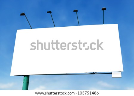 Big blank billboard with lamp on blue sky background - stock photo
