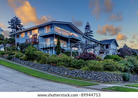 Big blue house with many balconies. - stock photo