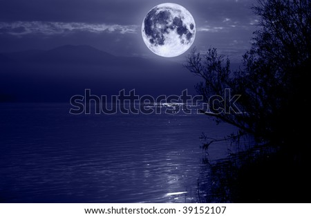 Big blue moon over water. Elements of this image furnished by NASA. - stock photo