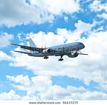 Big blue passenger plane at bright blue sky - stock photo