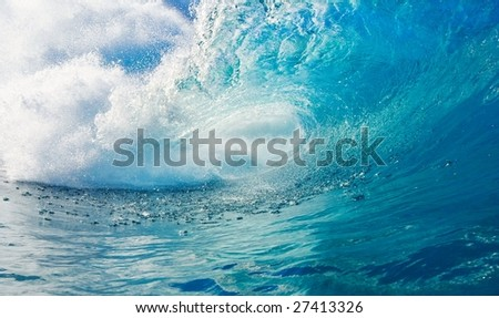 Big Blue Wave Breaks in Tropical Ocean, View into the Tue, a Surfers Perspective - stock photo