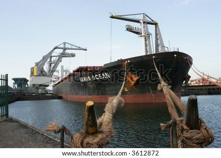Big boat unloading - stock photo