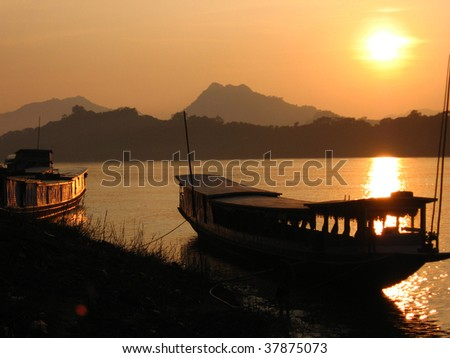 big boats on Mekhong bank at sunset
