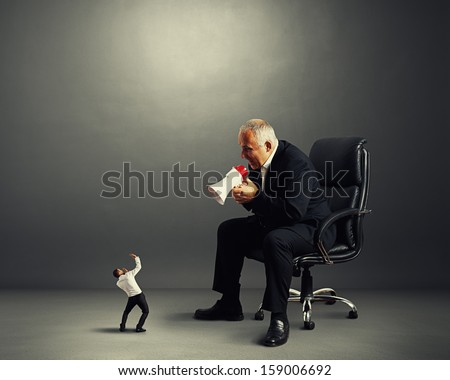 big boss screaming at small businessman - stock photo