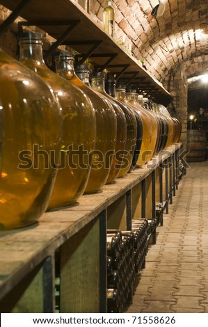 Big  bottles of high quality wine in the traditional wine cellar - stock photo