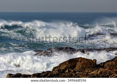 Big breaking waves in a beautiful sunny day. North of Portugal - stock photo