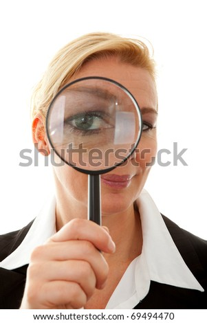 Big brother is watching you: business woman with magnifying glass to the eye over white background - stock photo