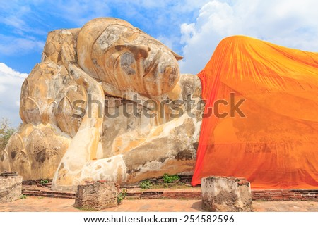 big buddha lay down outdoor  in blue sky day