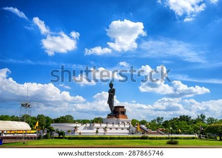Big Buddha statue at phutthamonthon, Nakhon Pathom, Thailand, on beautiful clouds and blue sky background - stock photo