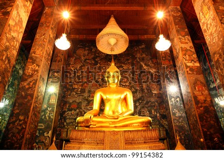 Big buddha statue beautiful in the church of the Suthat  Wat at Bangkok, Thailand - stock photo