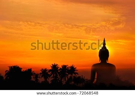 Big buddha statue in sunset - stock photo