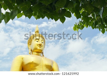 Big Buddha statue with Bodhi or Peepal Leaf foreground in Thailand