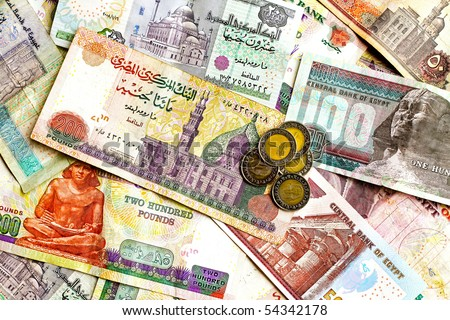 Big bunch of colorful Egyptian banknotes and coins - stock photo