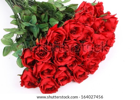 Big bunch of red roses on white background