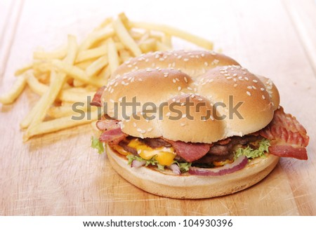 Big burger and chips on the table