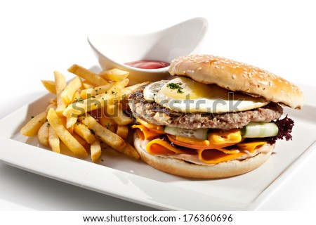 Big Burger with French Fries and Sauce - stock photo