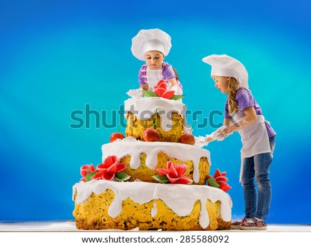 Big cake with roses and children - stock photo