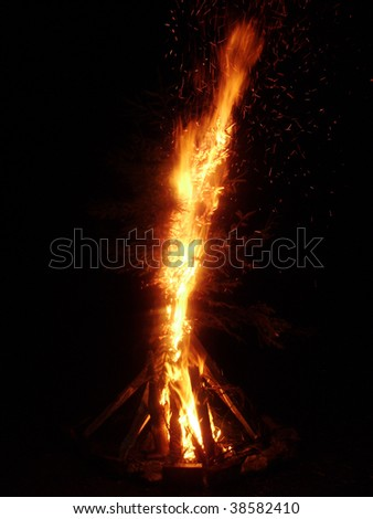 Big Camp fire at night totally dark background