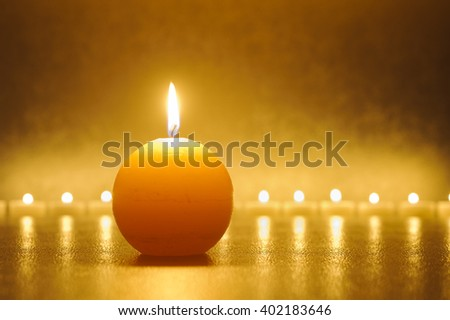 big candle light in warm color - stock photo