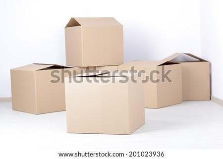 Big cardboard boxes standing insinde a room - stock photo
